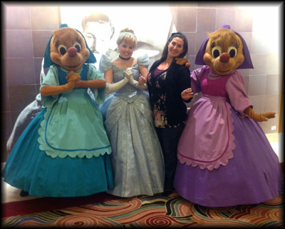 With Cinderella and her seamstress-friend-mice! Now if only Fairy Godmother was there to take a picture...