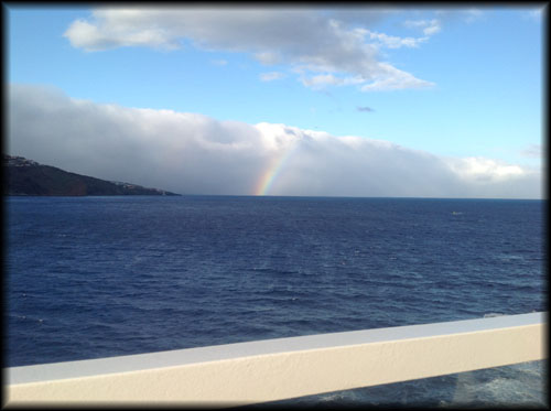 A rainbow sees The Magic off at Funchal, Madeira.