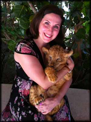 Holding a baby lion cub in Costa Maya, Mexico
